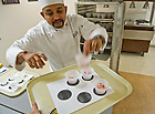 Oct. 23, 2013; Notre Dame Test Kitchen Chef Charu Pant places samples of strawberry ice cream on a tray for tasting and review in the test kitchen in the basement of North Dining Hall.<br /> <br /> Photo by Matt Cashore/University of Notre Dame