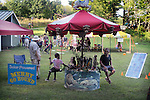 The Solar Powered Merry-Go-Round in the Kids Zone, on the 2nd day of the 4th Annual Summer Hoot Festival held at the Ashokan Center, Olivebridge, NY, on Saturday, August 27, 2016. Photo by Jim Peppler; Copyright Jim Peppler 2016.