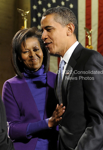 Philadelphia, PA - January 17, 2009 -- United States President-elect Barack Obama is embraced by his wife, Michelle, after delivering remarks during a rally to kickoff his Whistle Stop Train Tour in Philadelphia on Saturday, January 17, 2009. The ceremonial trip will carry President-elect Obama, Vice President-elect Biden and their families to Washington for their inaugurations with additional events in Philadelphia, Wilmington and Baltimore. Obama will be sworn in as the 44th President of the United States on January 20, 2009..Credit: Kevin Dietsch - Pool via CNP