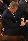 United States President George W. Bush bows his head in prayer during the National Day of Prayer Service at the Washington National Cathedral in Washington, D.C. on Friday, September 14, 2001.  .Credit: Ron Sachs / CNP