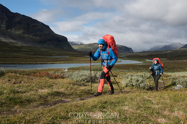 Two hikers on trail south of Singi hut, Kungsleden trail, Lapland, Sweden