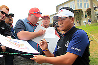 K.J.Choi (KOR) signs autographs for fans at the 8th hole during Wednesday's Practice Day of the 112th US Open Championship at The Olympic Club, San Francisco,  California, 13th June 2012 (Photo Eoin Clarke/www.golffile.ie)