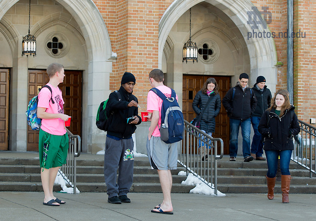 Feb. 6, 2013; Wearing T-shirts and flip-flops, Notre Dame students Duncan Campbell (left) and Michael Murray, collect donations for the South Bend Center for the Homeless, in front of South Dining Hall. Photo by Barbara Johnston/University of Notre Dame