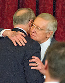 United States Senate Minority Leader Harry Reid (Democrat of Nevada) hugs US Senator Chuck Schumer (Democrat of New York) during the ceremony where his official portrait is to be unveiled in the Kennedy Caucus Room on Capitol Hill in Washington, DC on Thursday, December 8, 2016.<br /> Credit: Ron Sachs / CNP