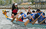 Vancouver, Canada, Aug 8th 2009. World Police and Fire Games, Dragon Boat Competition.  Members of the NSW Fiberglass Flyers team race in the Mixed Senior 10.  The boat has 10 paddlers, a drummer, and a sweep (in the back with the rudder).  Photo by Gus Curtis