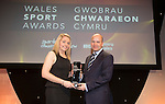 Wales Sport Awards 2013<br /> Kat Lovett receiving her award from Jonathan Ford.<br /> 09.11.13<br /> ©Steve Pope-SPORTINGWALES