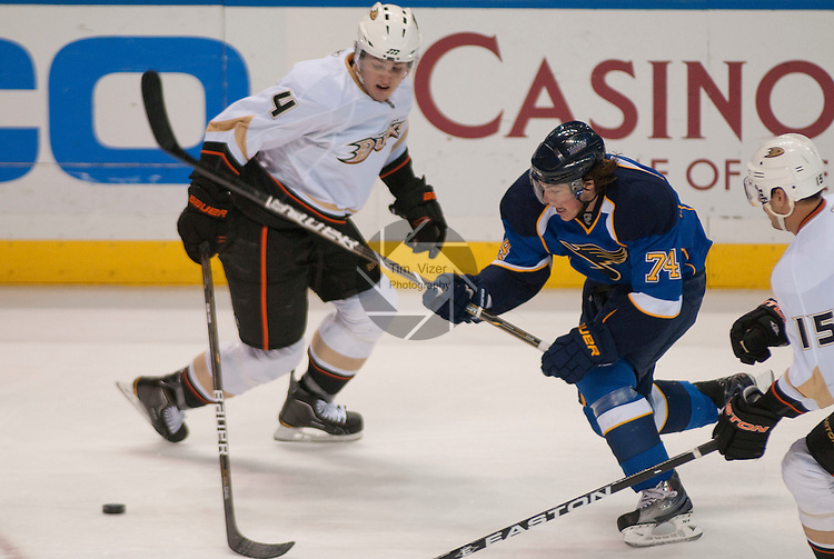 February 19,  2011       St. Louis Blues center T.J. Oshie (74, center) fights for the puck against Anaheim Ducks defenseman Cam Fowler (4, left) and Anaheim Ducks center Ryan Getzlaf (15) in the first period. The St. Louis Blues defeated the Anaheim Ducks 9-3 on Saturday February 19, 2011 at the Scottrade Center in downtown St. Louis.