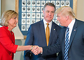United States President Donald J. Trump, right, shakes hands with US Representative Claudia Tenney (Republican of New York), left, as US Senator David Perdue (Republican of Georgia), center, looks on prior to signing three Executive Orders concerning financial services at the Department of the Treasury in Washington, DC on April 21, 2017.<br /> Credit: Ron Sachs / Pool via CNP
