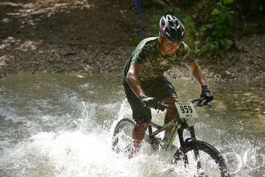 NWA Democrat-Gazette/BEN GOFF @NWABENGOFF<br /> Humberto Albarran of Springdale fords a creek Sunday, July 16, 2017, during cross country races on the final day of the 19th annual Fat Tire Festival at Lake Leatherwood City Park in Eureka Springs.