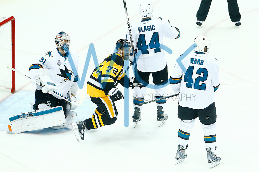 Patric Hornqvist #72 of the Pittsburgh Penguins celebrates following the game-winning goal by teammate Conor Sheary #43 of the Pittsburgh Penguins in overtime past Martin Jones #31 of the San Jose Sharks during game two of the Stanley Cup Final at Consol Energy Center in Pittsburgh, Pennslyvania on June 1, 2016. (Photo by Jared Wickerham / DKPS)