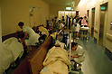 Victims of the Tokyo Subway Sarin Gass Attack receive treatment in the hallway of St. Luke's International Hospital in Tokyo on March 20, 1995. At around 8.00am in the morning members of the Aum Shirikyo Doomsday Cult released poisonous Sarin Gas in five coordinated attacks on trains travelling through Kasumigaseki and Nagatacho stations. This resulted in the death of 13 passengers and staff and over 6,000 injuries and was Japan's deadliest act of domestic terrorism.  (Photo by Yomiuri Newspaper/AFLO)