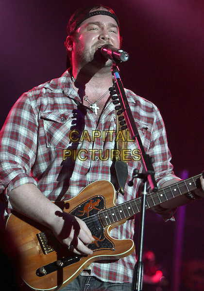 LEE BRICE.Lee Brice performs at Wild Bill's, Duluth, GA, USA, March 12th, 2010..music on stage live in concert gig microphone singing half length  plaid shirt cap hat  cross silver necklace playing guitar .CAP/ADM/DH.©Dan Harr/Admedia/Capital Pictures