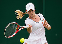 Alize Cornet<br /> <br /> Tennis - The Championships Wimbledon  - Grand Slam -  All England Lawn Tennis Club  2013 -  Wimbledon - London - United Kingdom - Friday 28th June  2013. <br /> &copy; AMN Images, 8 Cedar Court, Somerset Road, London, SW19 5HU<br /> Tel - +44 7843383012<br /> mfrey@advantagemedianet.com<br /> www.amnimages.photoshelter.com<br /> www.advantagemedianet.com<br /> www.tennishead.net