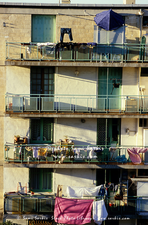 Washing drying on the balconies of an apartment building, Marseille, France.