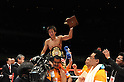 Tomonobu Shimizu (JPN),  Kentaro Kaneko,  Kenji Kaneko, AUGUST 31, 2011 - Boxing : Tomonobu Shimizu of Japan celebrates with his champion belt as Kaneko boxing gym president Kentaro Kaneko (2nd R) and manager and trainer Kenji Kaneko (3rd R) look on after winning the WBA super flyweight title bout at Nippon Budokan in Tokyo, Japan. (Photo by Mikio Nakai/AFLO)