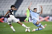 20th July 20202, Allianz Stadium, Turin, Italy; Serie A football league, Juventus versus Lazio; Paulo Dybala of Juve pulls the ball back despite the lunge from Luiz Felipe