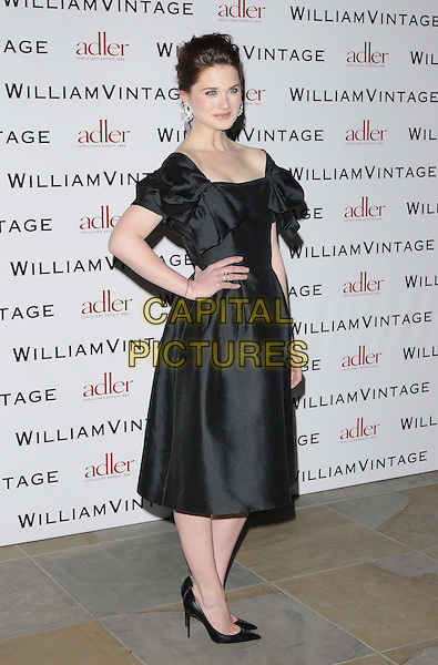 Bonnie Wright.attended the BAFTAs William Vintage dinner, St Pancras Renaissance London Hotel, Euston Rd., London, England, UK,.8th February 2013..BAFTA full length black dress ruffle silk satin hand on hip side shoes heels pointy .CAP/CAN.©Can Nguyen/Capital Pictures.