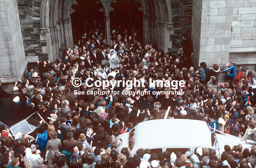 Wedding of Irish 1970 Eurovision-winning singer, Dana, aka Rosemary Brown, from Londonderry, N Ireland, and Damien Scallon, hotelier, Newry, N Ireland, in St Eugene's Cathedral, Londonderry on 5th October 1978. Bride and groom emerge from the cathedral to be greeted by hundreds of wellwishers. 197810050265c.<br />