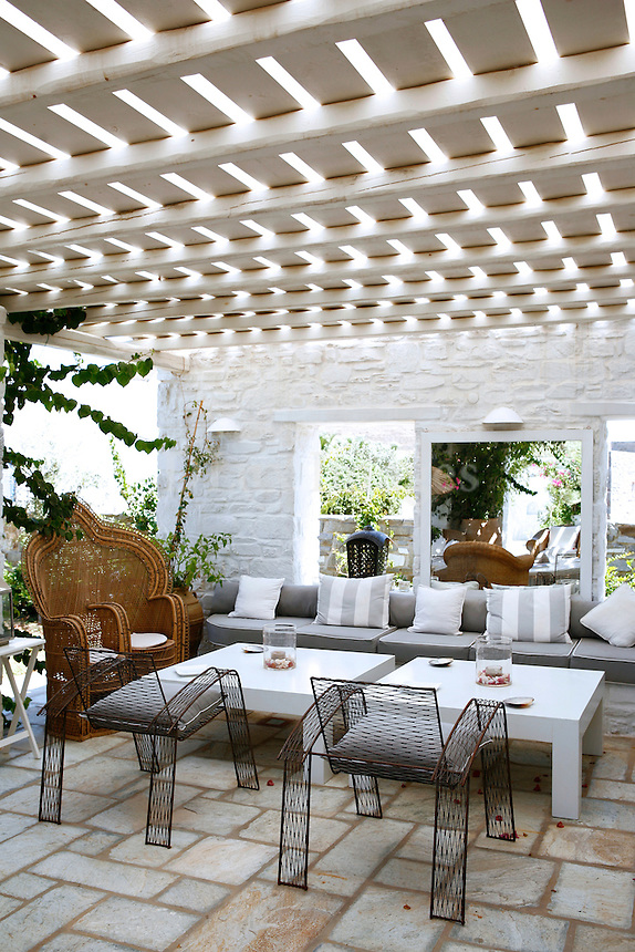 The house which was purchased in 2005 was a dream for Yiaguel Didier. Made of white stone, the house looks like it is engraved on the landscape of Paros as an integral part of it.