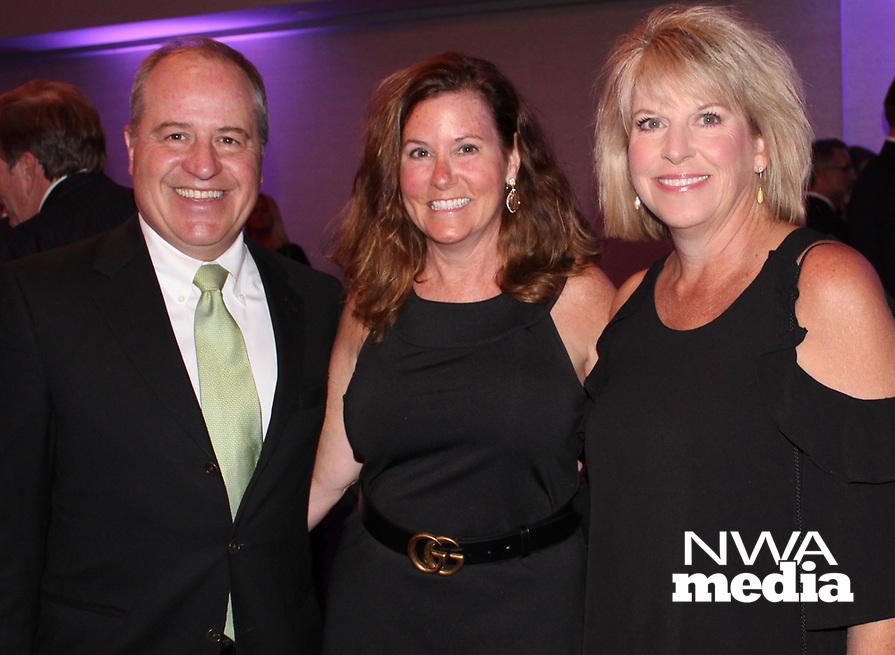 NWA Democrat-Gazette/CARIN SCHOPPMEYER Dr. Greg and Julie Oakhill (from left) visit with Laura Duke at the Eagle Awards Gala.