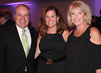 NWA Democrat-Gazette/CARIN SCHOPPMEYER Dr. Greg and Julie Oakhill (from left) visit with Laura Duke at the Eagle Awards Gala.