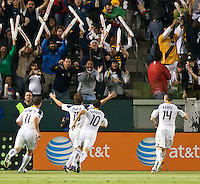 CARSON, CA - November 3, 2011: LA Galaxy teammates Chad Barrett (11), Landon Donovan (10) and Robbie Keane (14) celebrate Mike Magee's (18) goal during the match between LA Galaxy and NY Red Bulls at the Home Depot Center in Carson, California. Final score LA Galaxy 2, NY Red Bulls 1.