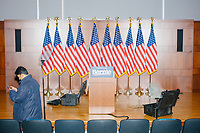 "An empty podium and American flags stand on stage after Democratic presidential candidate and Vermont senator Bernie Sanders delivered his response to President Donald Trump's State of the Union address earlier that night at The Currier Museum of Art in Manchester, New Hampshire, on Tue., Feb. 4, 2020. Sanders' speech began, ""Tonight, we just listened to Donald Trump's third, and what I believe will be his very last, State of the Union Address."""
