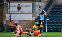 Paul Hayes of Wycombe Wanderers skips past Jake Howells of Luton Town in the area during the Sky Bet League 2 match between Wycombe Wanderers and Luton Town at Adams Park, High Wycombe, England on 6 February 2016. Photo by Andy Rowland.