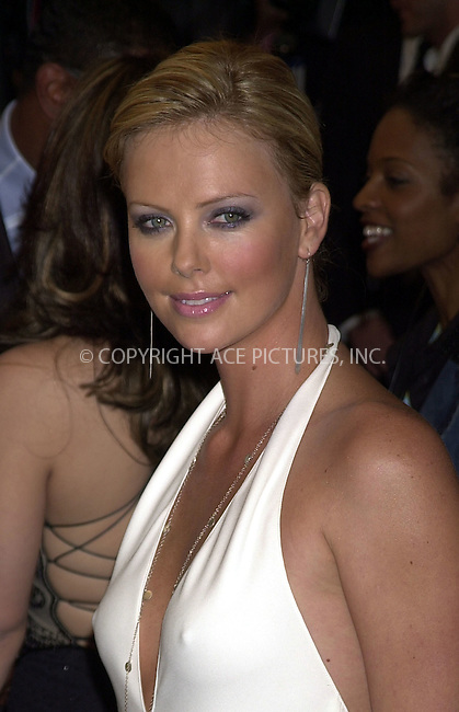 Charlize Theron arriving at GQ Men of the Year Awards. October 21, 2003. Please byline: NY Photo Press.   ..*PAY-PER-USE*      ....NY Photo Press:  ..phone (646) 267-6913;   ..e-mail: info@nyphotopress.com