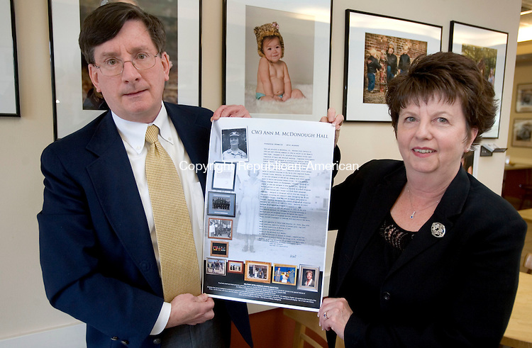 WOODBURY, CT. 02 May 2012-050212SV06-From left, Thomas McDonough of Waterbury and his sister Eilene Calli of Waterbury hold a copy of a poster hanging in a building that was dedicated to their aunt, Ann M. McDonough in Baltimore Maryland. Ann M. McDonough  was an American spy in WWll..Steven Valenti Republican-American