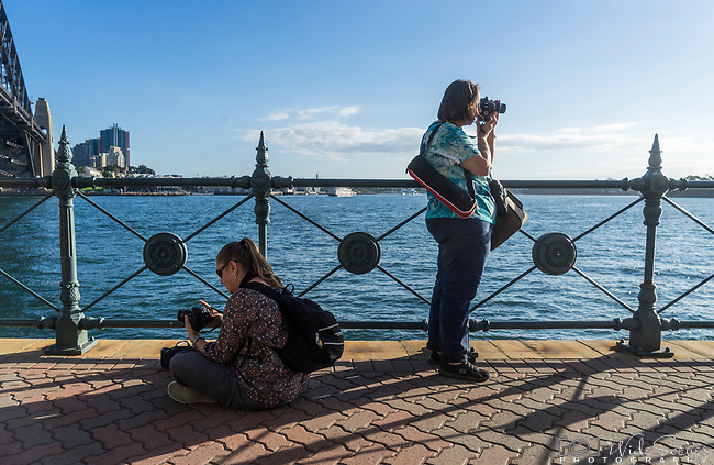 Photo walk attendees on the foreshore of Sydney Harbour, North Sydney, NSW, Australia
