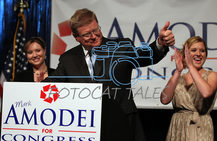 Mark Amodei speaks at a victory party in Reno, Nev., Sept. 13, 2011, after defeating Democrat Kate Marshall  in a special election for Nevada's 2nd Congressional District. Amodei's daughters Erin, left, and Ryanne were among 200 supporters on hand. (AP Photo/Cathleen Allison)
