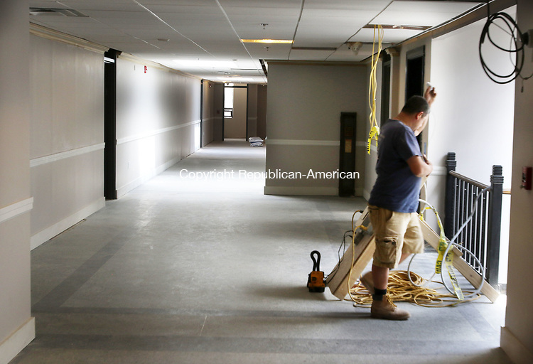 WATERBURY CT. 26 July 2017-072617SV15-A worker puts the final touches on a hallway in the new dorms at the Brown Building across the street from UConn Waterbury Wednesday. <br /> Steven Valenti Republican-American
