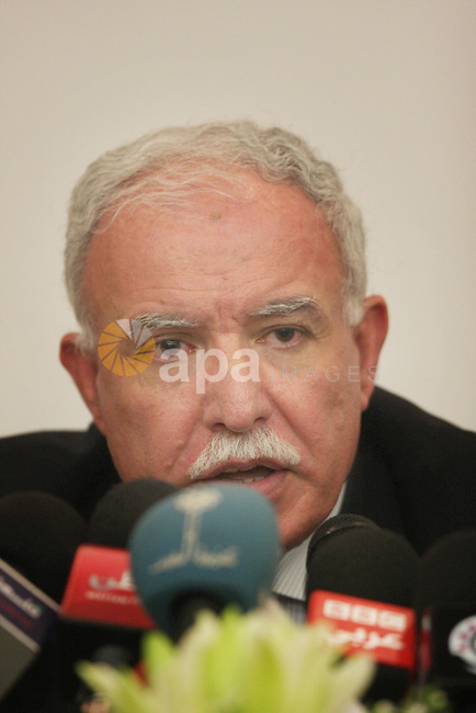 Palestinian foreign minister Riad al-Malki speaks to the press in the West Bank city of Ramallah on August 5, 2012, as Non-Aligned Movement (NAM) ministers gather in the neighboring Jordanian capital Amman to take part in the NAM's Committee on Palestine that was to have taken place in Ramallah, but was cancelled after Israel denied five NAM members entry. The ministers were to have attended a two-day meeting of the movement's Palestine Committee at which they were poised to sign a declaration supporting a fresh Palestinian bid for upgraded UN membership. Photo by Issam Rimawi