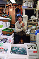 A market worker taking a break, Tsukiji fish market, Tokyo, Japan, January 9 2007.
