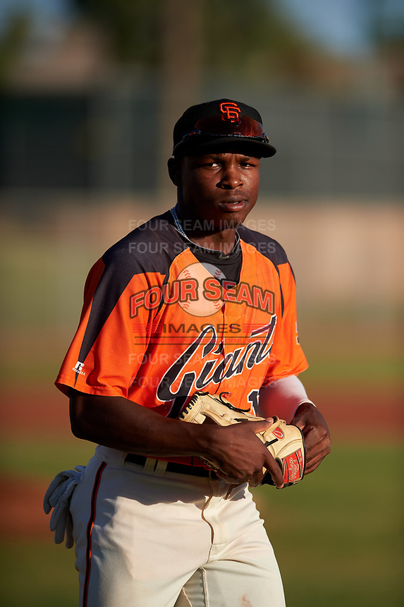AZL Giants Orange center fielder P.J. Hilson (16) jogs onto the field between innings of a game against the AZL Angels at Giants Baseball Complex on June 17, 2019 in Scottsdale, Arizona. AZL Giants Orange defeated AZL Angels 8-4. (Zachary Lucy/Four Seam Images)