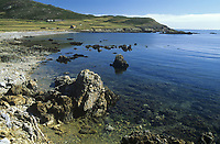 A rocky shore at high tide on Bardsey Island, off the coast of Wales, United Kingdom.