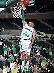 North Texas Mean Green guard Dominique Johnson (1) goes in for a lay up during the NCAA  basketball game between the South Alabama Jaguars and the University of North Texas Mean Green at the North Texas Coliseum,the Super Pit, in Denton, Texas. UNT defeated South Alabama 82 to 79...