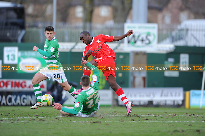 Kevin Dawson of Yeovil Town tackles Febian Brandy of Walsall - Yeovil Town vs Walsall - NPower League One Football at Huish Park, Yeovil, Somerset - 29/03/13 - MANDATORY CREDIT: Denis Murphy/TGSPHOTO - Self billing applies where appropriate - 0845 094 6026 - contact@tgsphoto.co.uk - NO UNPAID USE.