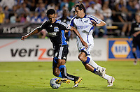 Andre Luiz (left) defends the ball against Santiago Hirsig (right). The San Jose Earthquakes defeated the Kansas City Wizards in stoppage time 1-0 at Buck Shaw Stadium in Santa Clara, California on August 22, 2009.