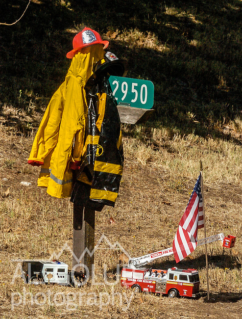 September 20, 2004 Columbia, California --Tuolumne Fire –- Tribute to Eva Marie Schicke on Parrots Ferry Road.  The memorial service for fallen firefighter Schicke was held at the Calaveras County Fairgrounds.  The Tuolumne Fire was a small very fast-moving fire that started around noon on September 12, 2004 near Lumsden Bridge at the bottom of the Tuolumne River.  The fire moved rapidly up the 80-plus-degree slope catching Cal Fire Helitack firefighters, tragically killing firefighter Eva Marie Schicke and injuring five others.