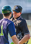 29 June 2014:  MiLB Umpire Justin Houser has a friendly chat with Vermont Lake Monsters Manager David Newhan during a game against the Lowell Spinners at Centennial Field in Burlington, Vermont. The Lake Monsters fell to the Spinners 7-5 in NY Penn League action. Mandatory Credit: Ed Wolfstein Photo *** RAW Image File Available ****