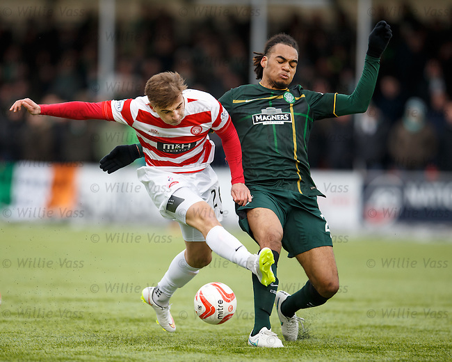 Eamonn Brophy of Hamilton has his shot blocked by Celtic's Jason Denayer
