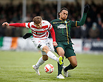 Eamonn Brophy of Hamilton has his shot blocked by Celtic's Jason Denayer