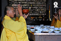 Monks in temple praying before lunch (Licence this image exclusively with Getty: http://www.gettyimages.com/detail/83154218 )
