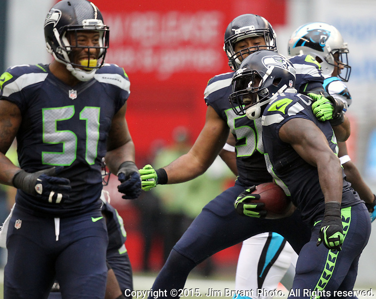 Seattle Seahawks  Safety Kam Chancellor celebrates with Bruce Irvin (51) and K.J. Wright (50) after intercepting a pass extended for Carolina Panthers  tight end Ed Dickson (84) at CenturyLink Field in Seattle on October 18, 2015. The Panthers came from behind with 32 seconds remaining in the 4th Quarter to beat the Seahawks 27-23.  ©2015 Jim Bryant Photography. All Rights Reserved.