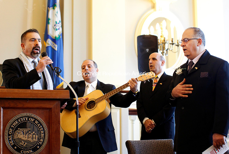 Waterbury, CT- 26 January 2013-012613CM02- Nehme Atallah, left, sings the Lebanese National Anthem as  Waterbury's Lebanese Mayor for the Day, Camille Atallah shows his respects during a ceremony Saturday morning at City Hall in Waterbury. Camille Atallah was born in Beirut, Lebanon, the fifth of ten children.  He would later win a full scholarship to Saint Anthony De-Padua University in Torino, Italy to study pre-medicine.  However after three months and concern for his families safety during wartime, he moved back to Lebanon.  Atallah would then graduate from the Holy Spirit University of Kaslik in Lebanon with a diploma of Architecture and Interior Design.  He eventually moved to the United States where he met his wife of 23 years, Marlene Jalkh and have four children.  Atallah is an active member of the Lion's Club, the Knights of Columbus and a longtime member of Our Lady of Lebanon Church in Waterbury, where he was ordained as a subdeacon.        Christopher Massa Republican-American