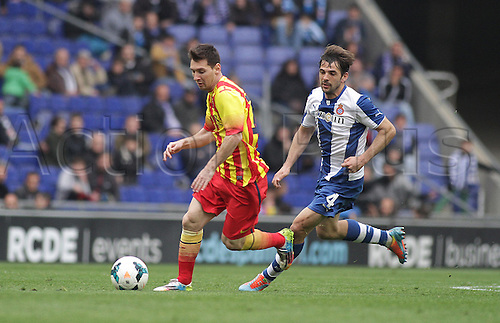 29.03.2014. Barcelona, Spain. Messi challenged by Victor (R)  during the Spanish La Liga game between Espanyol and Barcelona