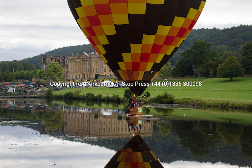 "04/09/15<br /> <br /> ***WITH VIDEO***<br /> <br /> Splash down!<br /> <br /> Hot air balloon pilots attempt to dip their baskets into the river Derwent before taking off again above Chatsworth House.  A mass launch at dawn this morning marked the start of the three-day Chatsworth Country Fair in the Derbyshire Peak District.<br /> <br /> A Chatsworth park ranger said: ""They try to do it every year, but I've only ever seen one manage it before - they need conditions to be perfect - I think it's like the holy grail for the pilots""<br /> <br /> Another crew member shouted down from his basket that his pilot didn't want to get his new shoes wet after failing to get low enough for a splash-down.<br /> <br /> <br /> All Rights Reserved: F Stop Press Ltd. +44(0)1335 418629   www.fstoppress.com."
