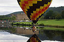 04/09/15<br /> <br /> ***WITH VIDEO***<br /> <br /> Splash down!<br /> <br /> Hot air balloon pilots attempt to dip their baskets into the river Derwent before taking off again above Chatsworth House.  A mass launch at dawn this morning marked the start of the three-day Chatsworth Country Fair in the Derbyshire Peak District.<br /> <br /> A Chatsworth park ranger said: &quot;They try to do it every year, but I've only ever seen one manage it before - they need conditions to be perfect - I think it's like the holy grail for the pilots&quot;<br /> <br /> Another crew member shouted down from his basket that his pilot didn't want to get his new shoes wet after failing to get low enough for a splash-down.<br /> <br /> <br /> All Rights Reserved: F Stop Press Ltd. +44(0)1335 418629   www.fstoppress.com.